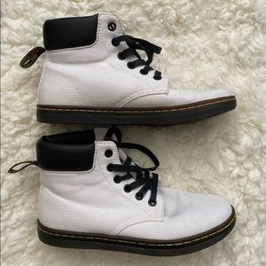 White with black canvas Dr Marten shoes.